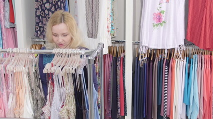 Woman looking for summer clothes in a clothing store