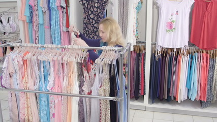 shopping for pregnancy clothes in baby and maternity shop