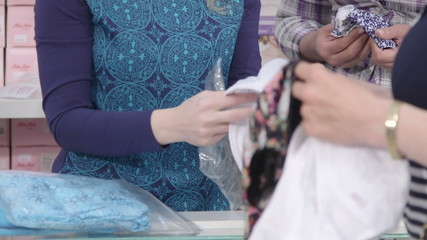 Women choose underwear in a clothing store close-up