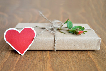 Paper heart and parcel wrapped in brown paper