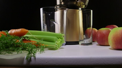 making freshly squeezed juice carrot apple and celery