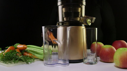 Making freshly squeeze juice from carrots and celery