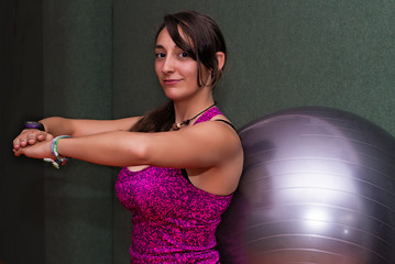 Woman doing pilates with fitball