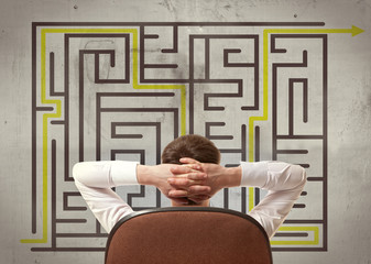 Businessman looking at a maze