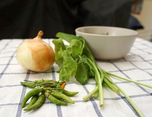 fresh vegetables on the checker board facric