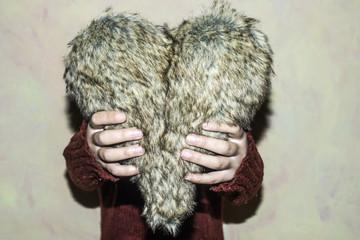 Women hold heart shape