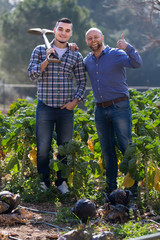 Two male farmers at plantation