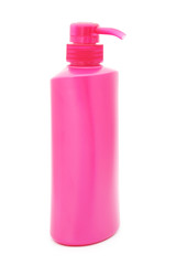 pink plastic pump cosmetic bottle on white background