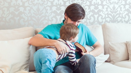 Dad and son in living-room
