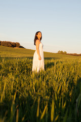 Woman looking at side relaxing on a meadow