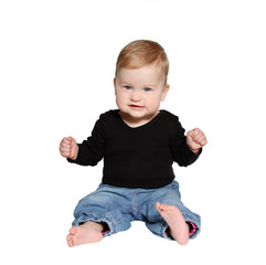 smiling baby sits on white background