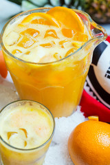 a decanter of bright summer cool refreshing orange lemonade on a