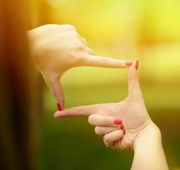 Close up of hands making frame gesture