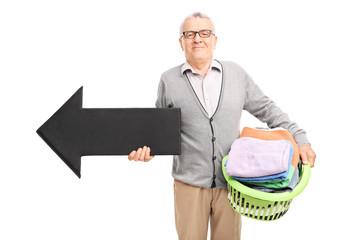 Senor holding a laundry basket and an arrow