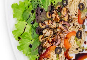 Sea salad with spaghetti.