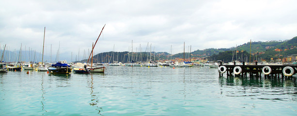 small italian harbor with boats and yachts