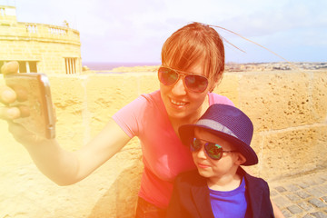mother and little son making selfie while travel in Europe
