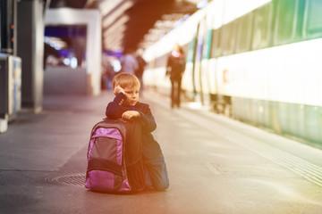 little boy waiting for the train on tube platform