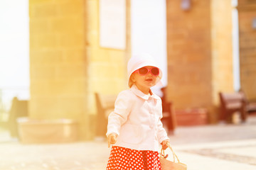 cute little lady travelling in the city