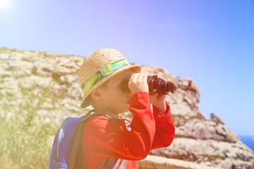little boy travel in mountains