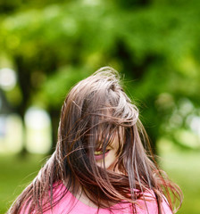 Hair covers woman face while jumping