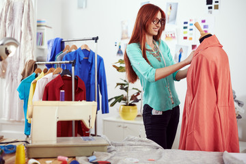 Designer working on a clothing material