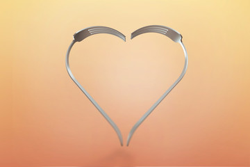 Forks heart on warm background