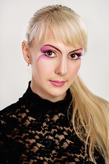 Close-up shot. Creative make-up of fashion lady
