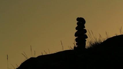 Zen stones in silhouette during sunset light