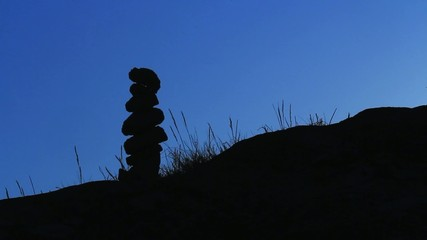 Zen stones silhouette during sunset light