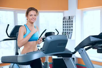 Happy woman on a treadmill