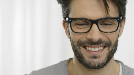 Laughing man wearing specs