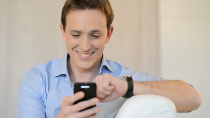 Young Man Texting On Cellphone