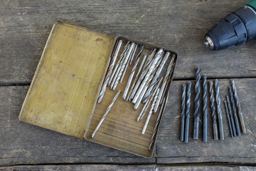 Set of antique tools on an old wood background. Drill and bits