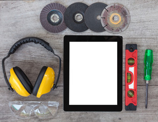 Top View of Digital Tablet and Assorted tools on wooden board, e