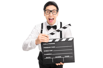 Excited movie director holding a clapperboard