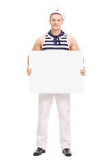Handsome sailor holding a blank banner