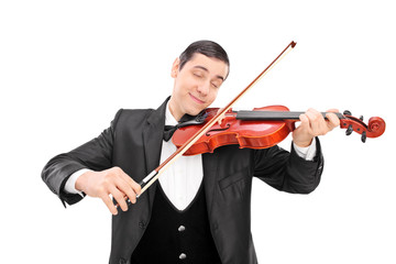 Young male musician playing an acoustic violin