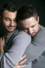 Gay couple on black background