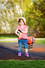 Cute toddler girl with chalk box