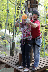 Couple climbing rope