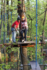 Couple climbing the rope