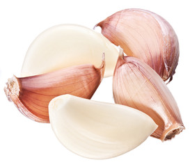 Lots of garlic cloves isolated on a white background.