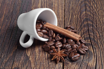 Cup with coffee beans, cinnamon and anise