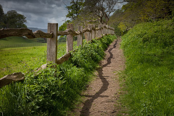 A rustic old wooden fence beside a path in Brecon, south Wales