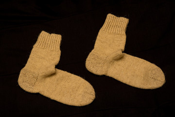 Pair of Knitted Socks on Dark Background