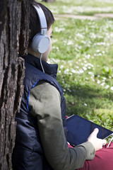 child listening to music on headphones