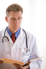 Doctors: Serious Physician with Test Results