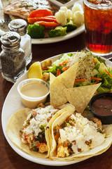 langostino tacos, also referred to as shrimp tacos