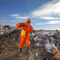 Environmentalist working on waste treatment on the landfill